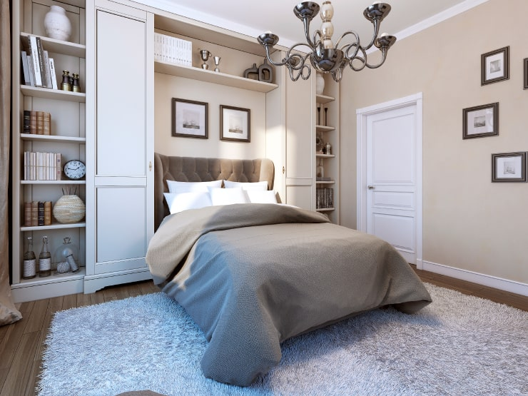 A bedroom with elegant photos on the walls
