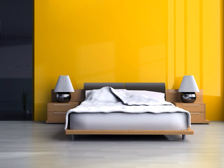 A bedroom with orange walls