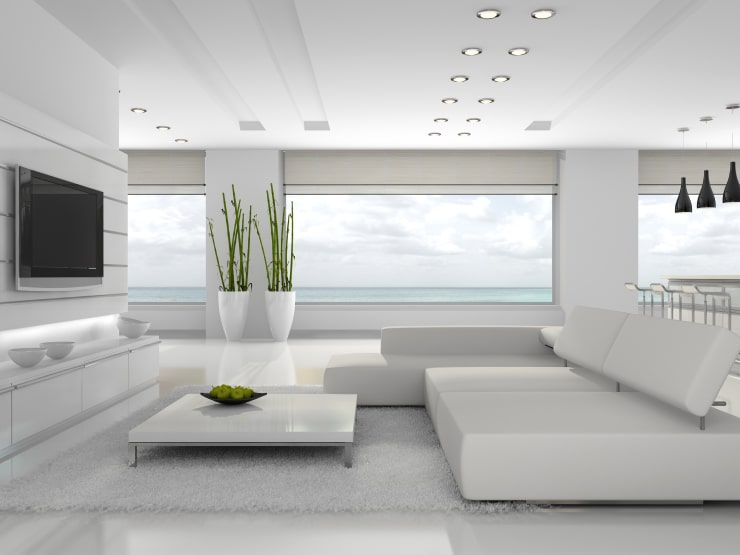 A stylish living room in white colors designed following feng shui rules