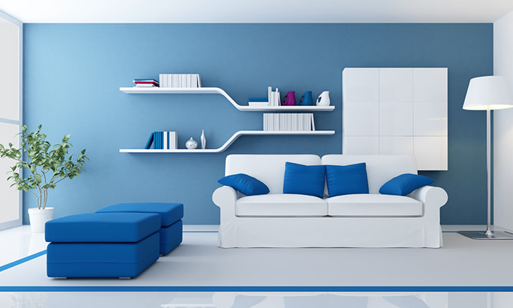 A living room designed in blue and white colors