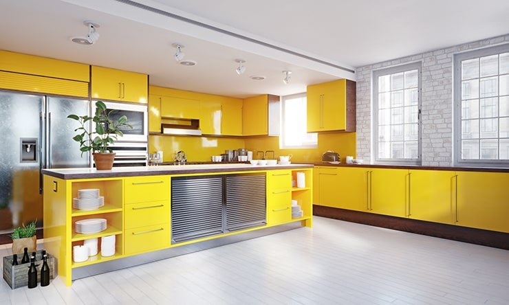 A kitchen with yellow furniture